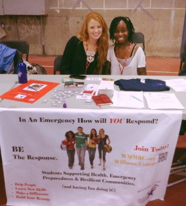 Co-directors tabling at the Purple Key Fair